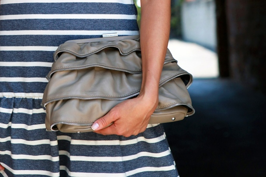 BCBGeneration ruffle zipper clutch