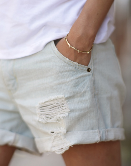 bing bang gold tiny skull bracelet distressed denim shorts