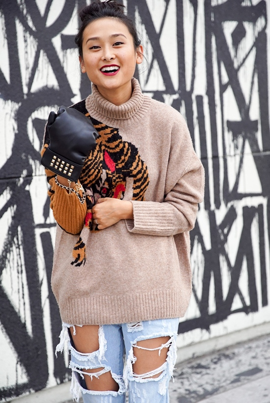 michelle-forstadt-top-knot-bun-hm-tiger-sweater-ripped-jeans